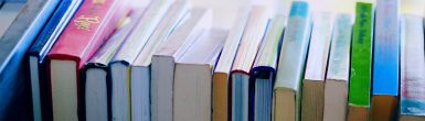 Image of books stacked on their side
